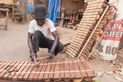 Man playing a Balafon