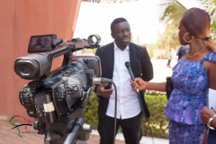 Woman interviewing a man on camera