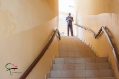 Man standing at the top of a set of stairs
