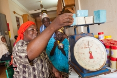 Woman weighing cosmetics on a scale