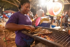 Woman getting food at a carnival