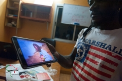 Artist showing his video on a tablet