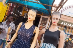 Mannequins in front of a clothing store
