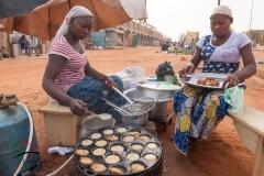Women cooking sorghum
