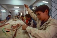 Men making carpets on a loom in Saqqara