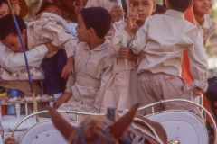 Children riding a horse drawn carriage in Luxor
