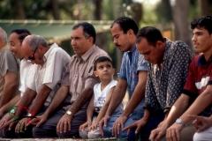 Men kneeling for prayer in Alexandria