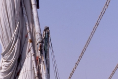 Man climbing the mast of a felucca