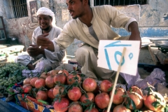 Street vendor selling fruit in a souk in Luxor