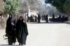 Women walking around wearing hijabs in Luxor