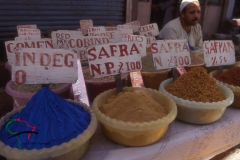 Street vendor selling spices at a souk in Luxor