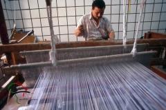 Man making carpets on a loom in Saqqara