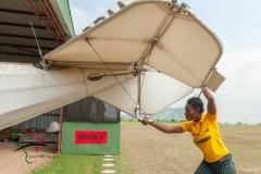A woman moving an ultralight aircrafts