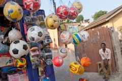 Street vendor selling athletic balls