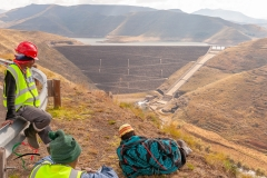 Workers relaxing while overlooking the Mohale Dam