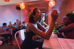 Woman smoking a cigarette in a restaurant