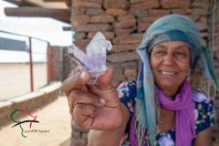 A crystal vendor holding a crystal.