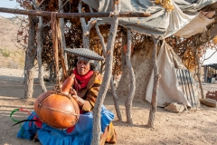 Woman from Herero Tribe churning butter.