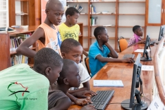 Children working on computers in the library