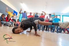 Student break dancing during theater class