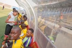 Children sitting down during soccer practice