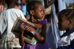 Girl holding school supplies in Dakar