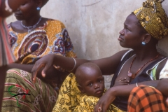 Mother sitting with her child in Ngor