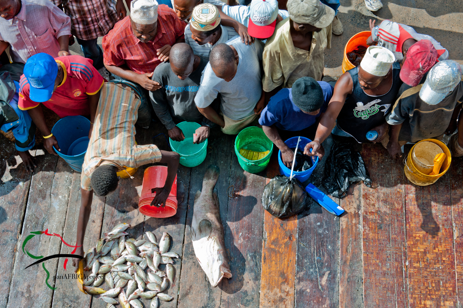 People purchasing fish at the Kivukoni fish market