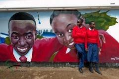 Two students standing in front of a mural