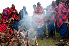 A group of Maasai people cooking meat