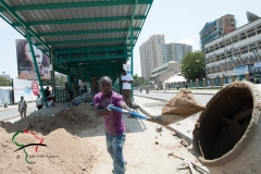 A man shoveling sand