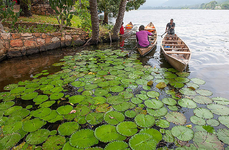Men on canoes on Lake Volta