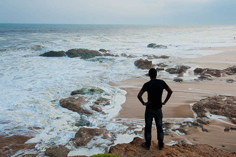 Man standing on a beach in Cape Coast