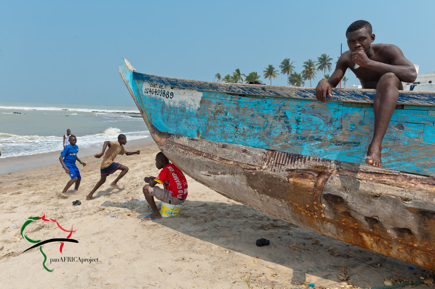 Fishing boat / soccer game. Gulf of Guinea, El Mina, Ghana