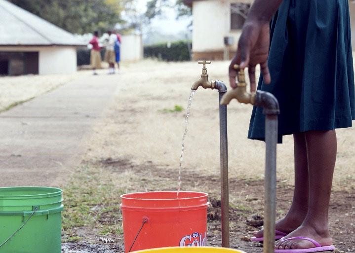 Retrieving water. Monduli, Tanzania