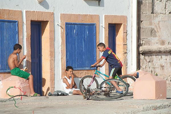 Children hanging out on bicycles in Essaouira