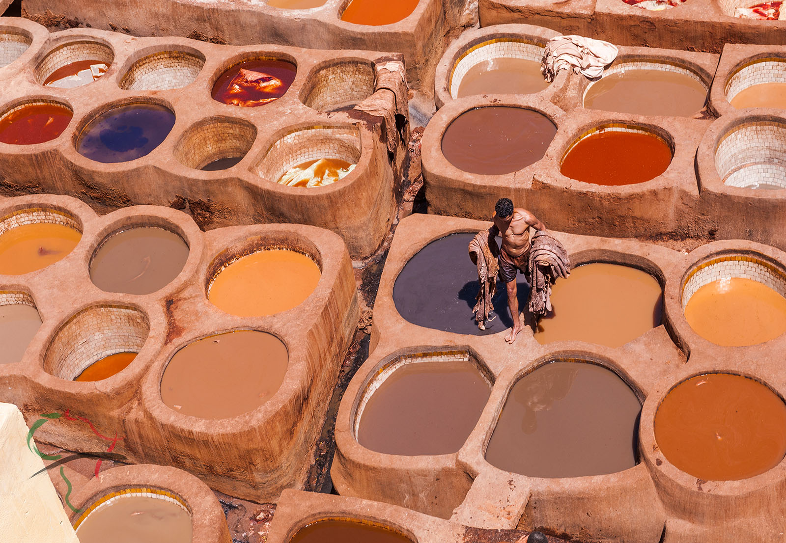 vats for dying leather in Chouara Leather Tannery. Fes